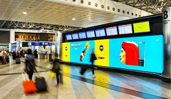 Pubblicità OOH in aeroporto IGPDecaux per Lavazza