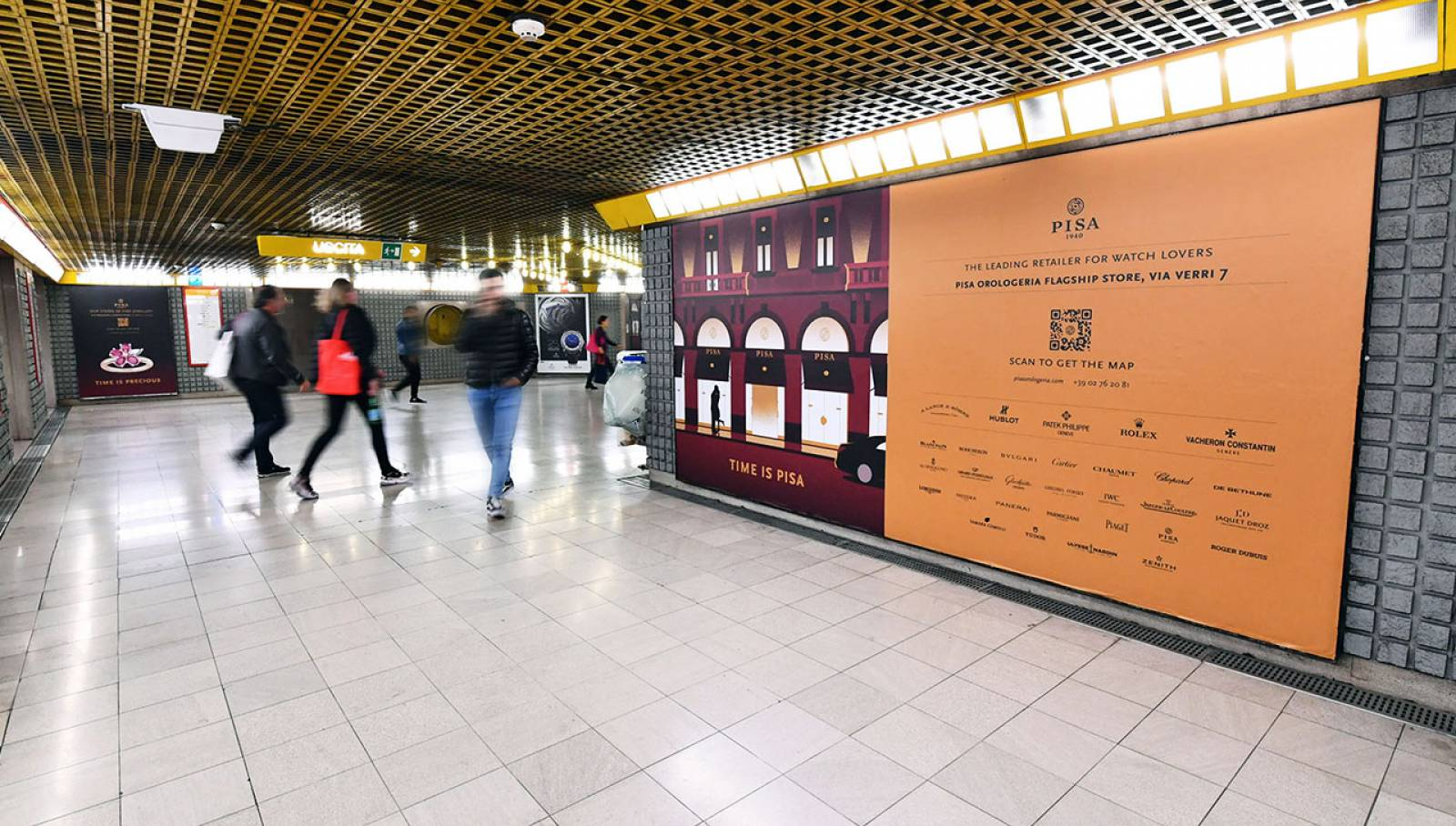 Pubblicità metro Milano IGPDecaux Station Domination per Pisa Orologeria