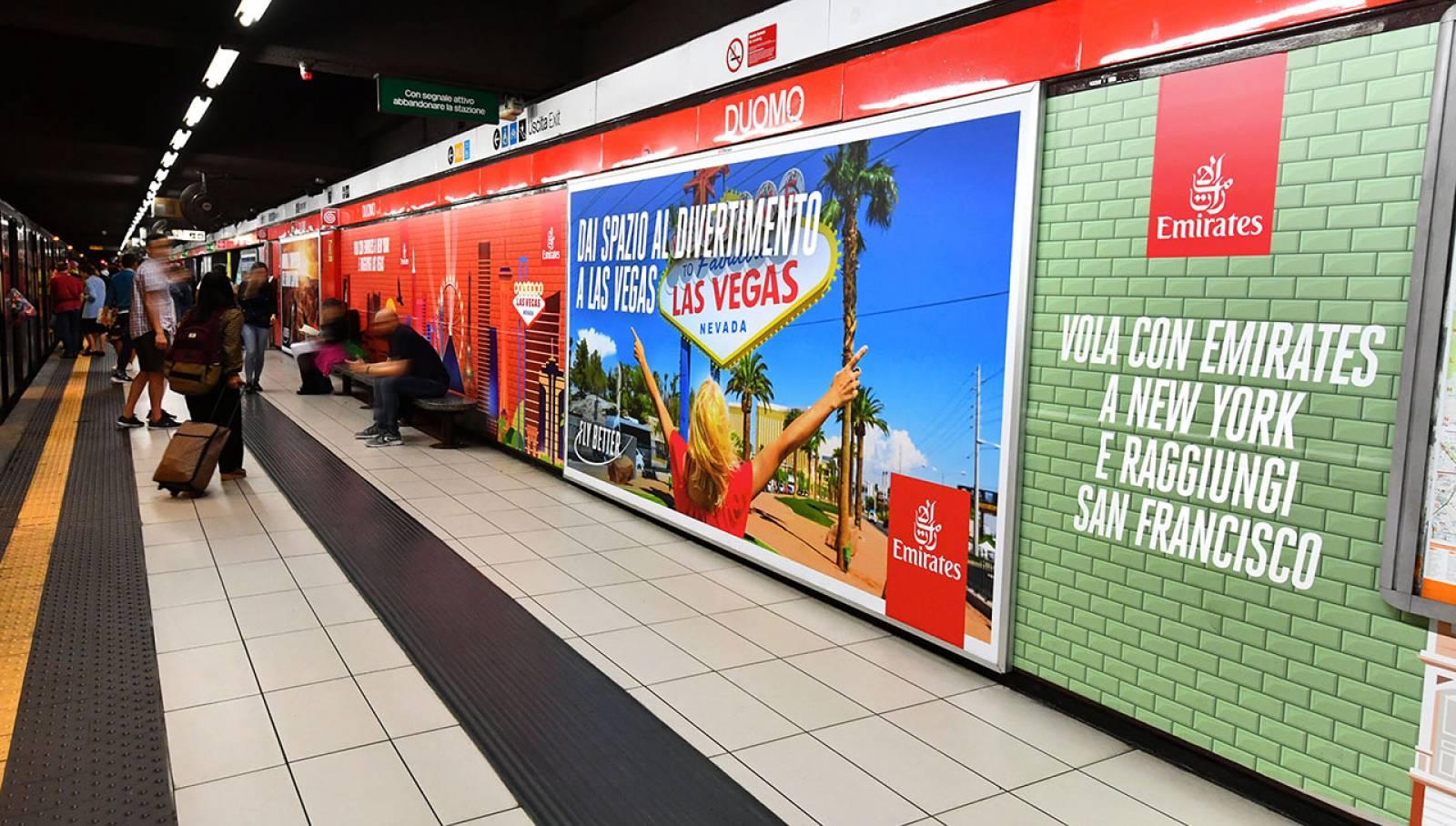 Pubblicità metro Milano IGPDecaux Station Domination per Emirates