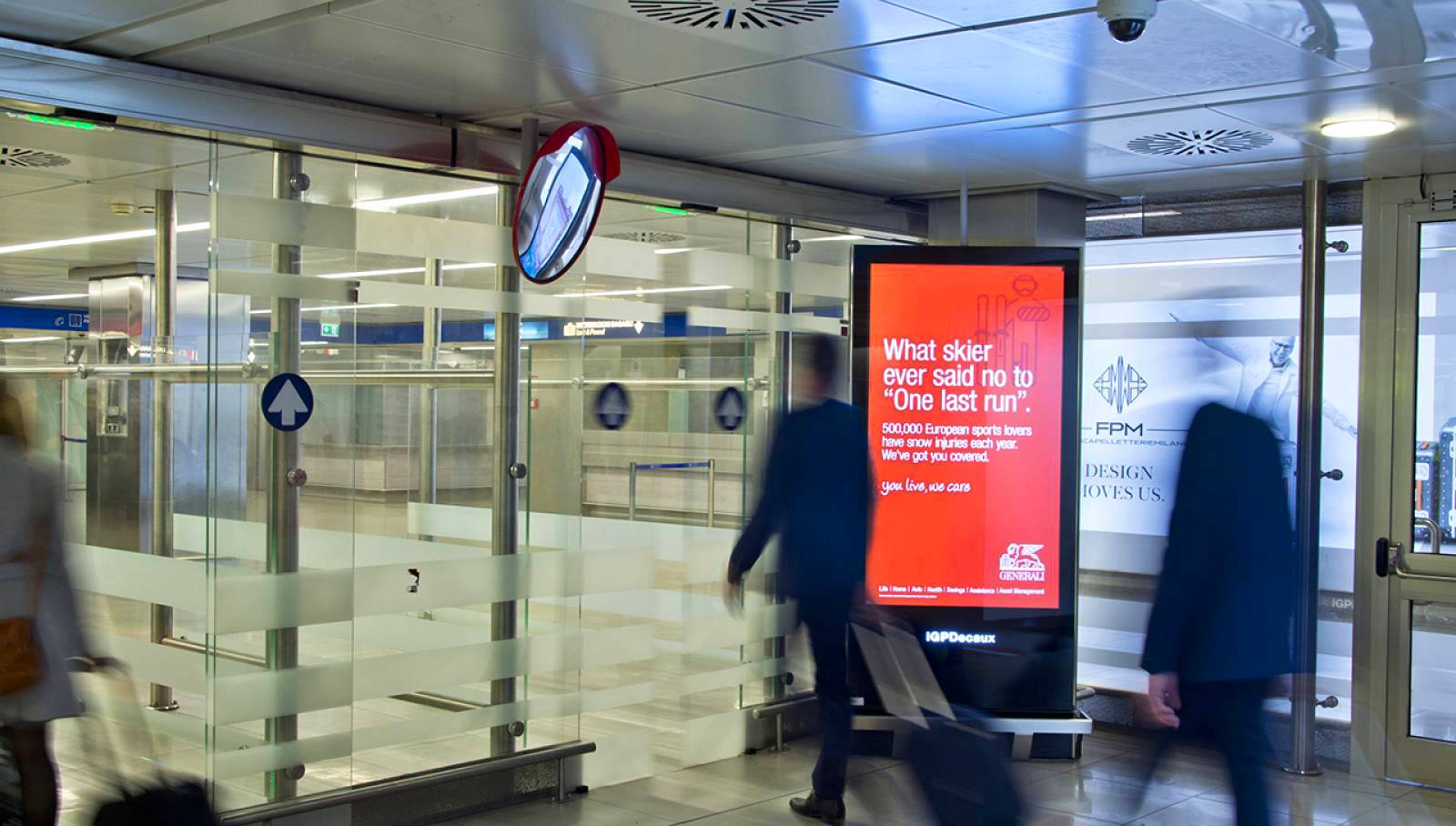 Dooh Advertising at Linate airport digital network IGPDecaux for Generali