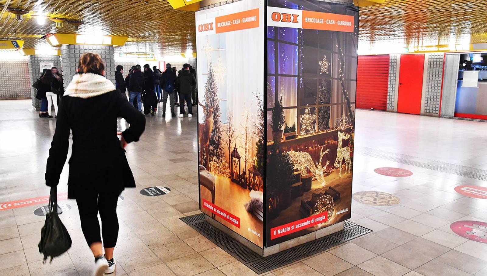 Pubblicità Out of Home IGPDecaux Milano Station Domination per OBI Italia Milano San Donato