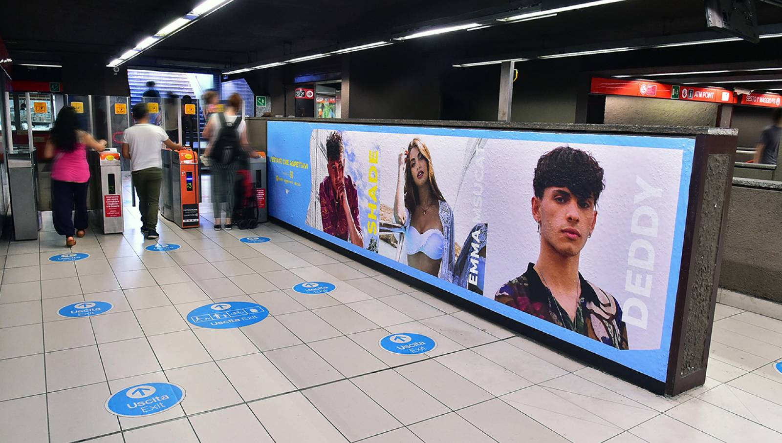 Pubblicità metro milanese IGPDecaux Station Domination per Warner Music Italy