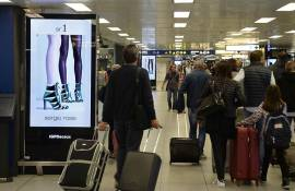 Airport advertising IGPDecaux airport digital network at Linate for Sergio Rossi