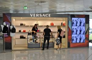 Airport advertising IGPDecaux Temporary for Versace at Malpensa