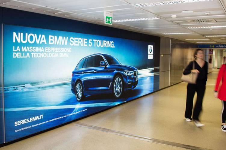 Airport advertising IGPDecaux Backlight at Linate for BMW
