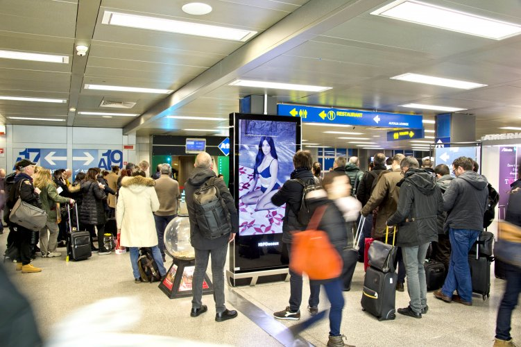 Airport advertising at Linate airport Vision network for Calvin Klein