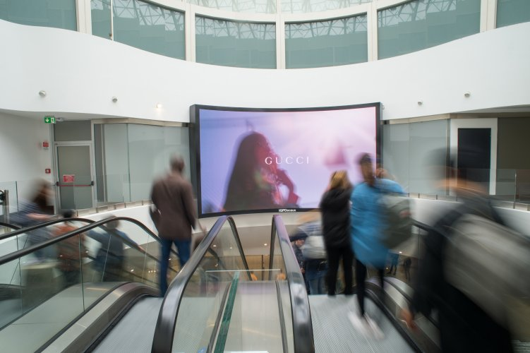 Airport advertising IGPDecaux at Malpensa videowall for Gucci