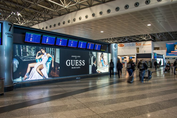 Airport Malpensa advertising backlight IGPDecaux for Guess