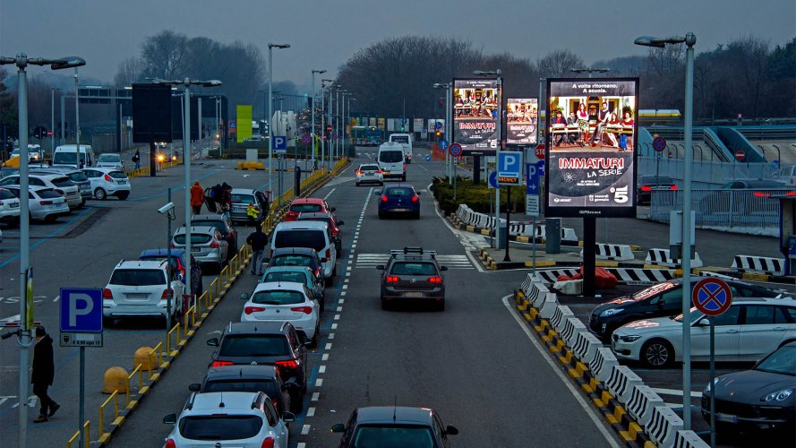 Airport advertising IGPDecaux 8sq m at Linate for Mediaset