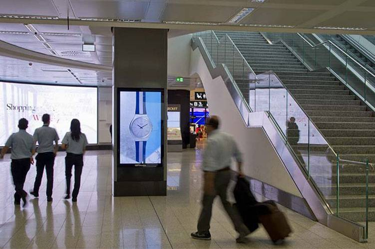 Airport advertising at Malpensa Airport Vision network IGPDecaux for Swatch
