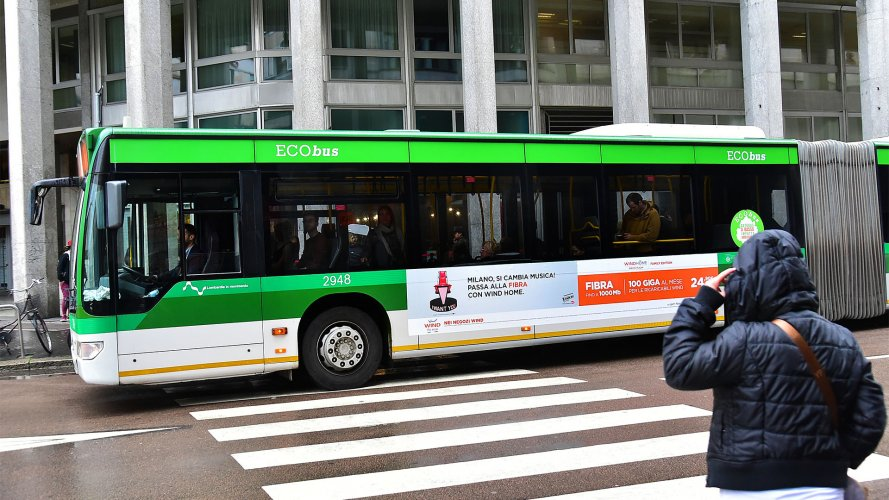 Bus advertising IGPDecaux Landscape Stickers in Milan for Wind 3 Fibra