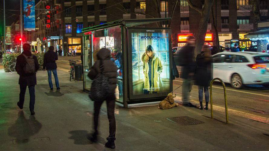 Outdoor advertising in Milan IGPDecaux brand shelter + Mupi for Woolrich