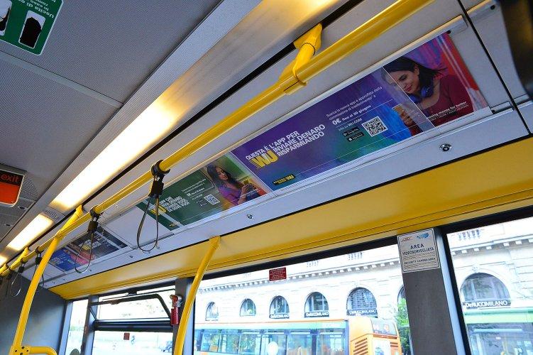 Pubblicità su autobus IGPDecaux Interno Vettura Dinamica a Milano per Western Union